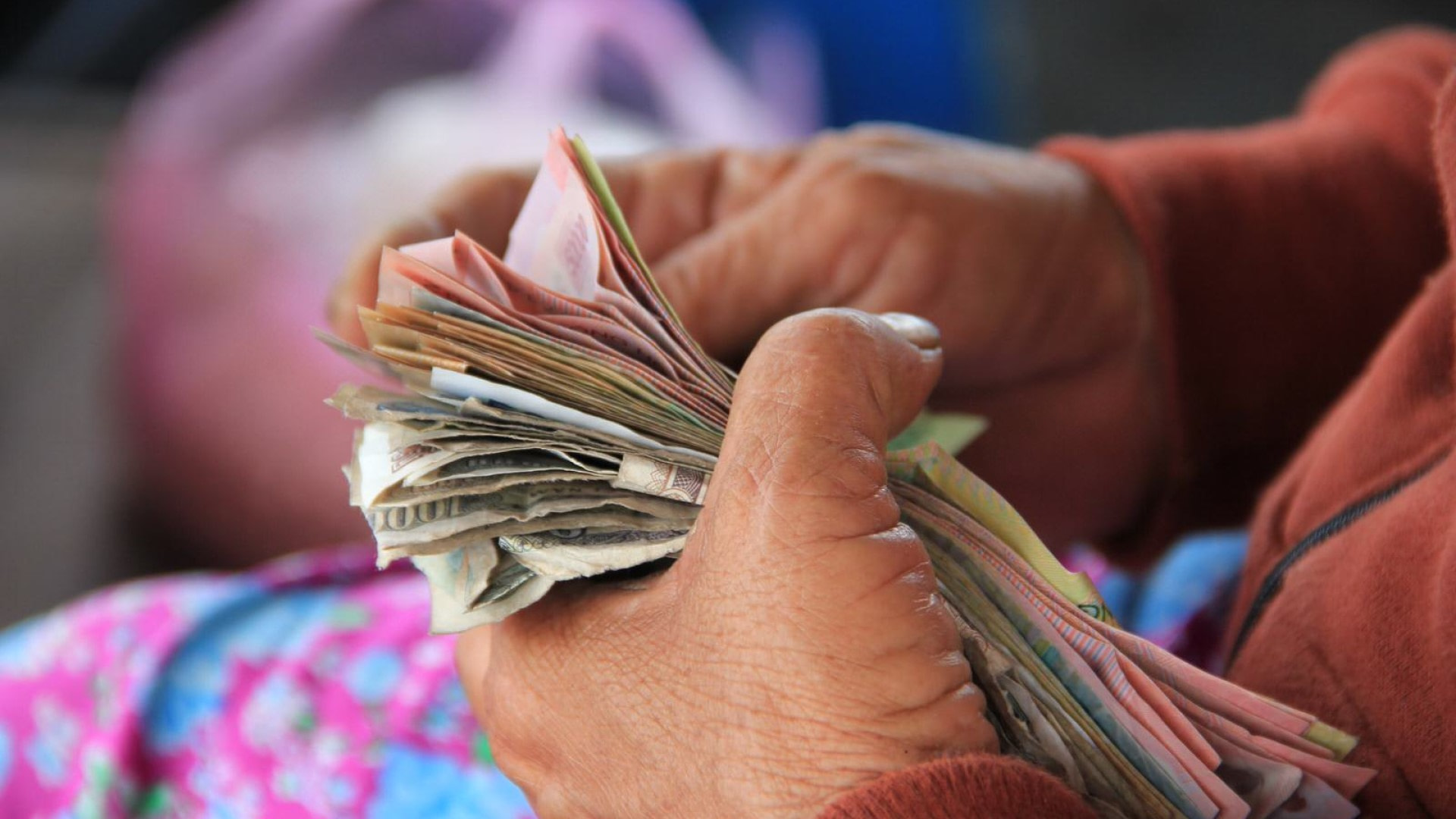 picture of a person counting money